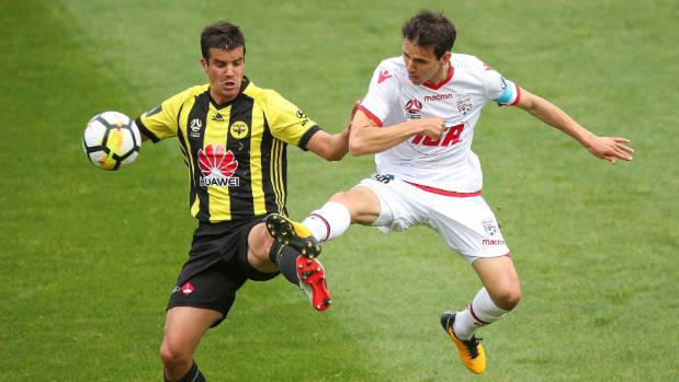 Adelaide United's Isaias, right, and Andrija Kaludjerovic of the Wellington Phoenix compete for the ball on Sunday.