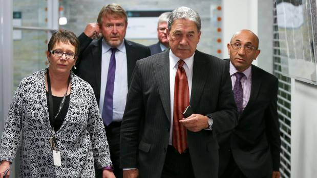 NZ First leader Winston Peters, Tracey Martin, deputy Ron Mark and advisor Paul Carrad emerge after one of many ...