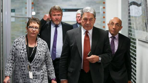 Winston Peters and his team emerge after another meeting.