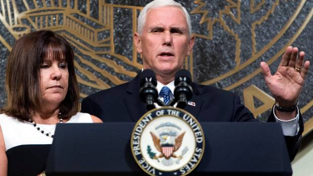 US Vice President Mike Pence is joined by his wife, Karen, as he speaks in Las Vegas City Hall.