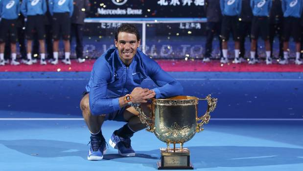Rafael Nadal poses with the trophy after beating Nick Kyrgios in the China Open final.