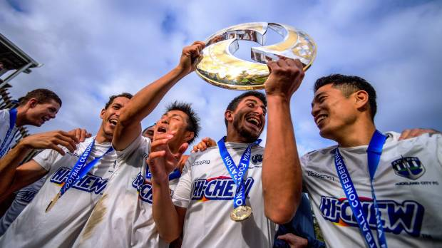 Auckland City players celebrate after defeating Team Wellington to win the 2017 Oceania Champions League.