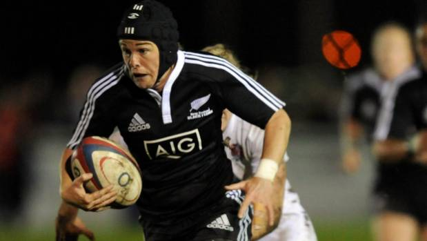 Halfback Emma Jensen on the charge for the Black Ferns against England.