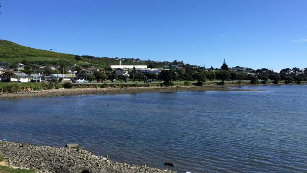 Looking over Porirua Harbour to Titahi Bay Rd. The city council says coastal erosion along the planned cycleway would ...