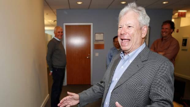 Thaler arrives at his Chicago office after winning the Nobel economics prize.