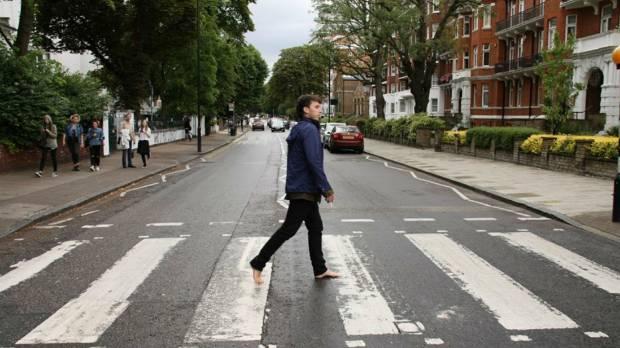 Walking across Abbey Road, London.