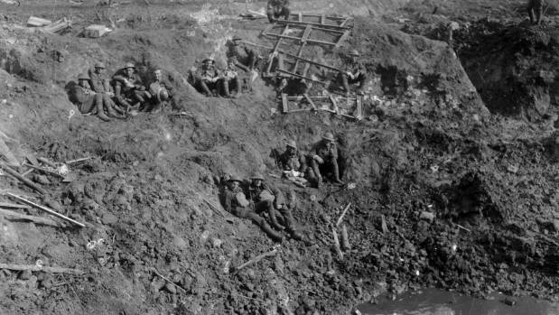 New Zealand Engineers resting in a large shell hole at Spree Farm Ypres Salient 12 October 1917