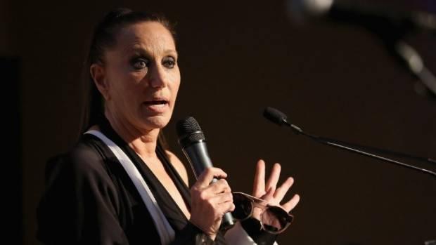 Fashion designer Donna Karan defends Harvey Weinstein amid sexual harassment scandal and blames victims.