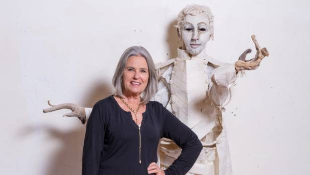 Nelson artist Sally Burton with the Arthur Wakefield figure she made out of wood and tapa cloth.