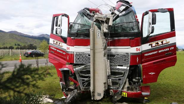 Firefighters used hydraulic rams to push the cab and windscreen off the driver so they could pull him out of the truck.