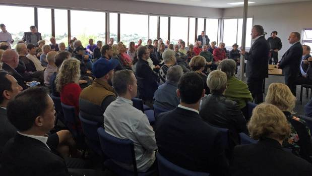 An estimated 100 people attended a meeting with Auckland Transport organised by MP Jonathan Coleman.