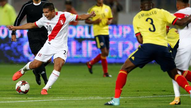 Peru's Edison Flores takes a shot against Colombia on Wednesday.