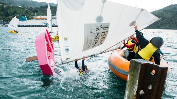 Holly Waring-Jones demonstrates recovering from a capsize with the Queen Charlotte Yacht Club.