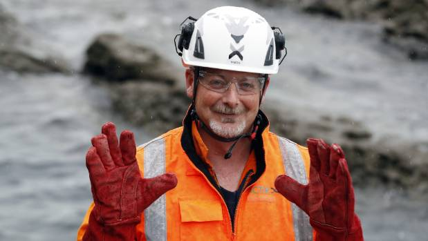 Simon Childerhouse shows off his seal-handling gloves, for when yelling and clapping just don't work.