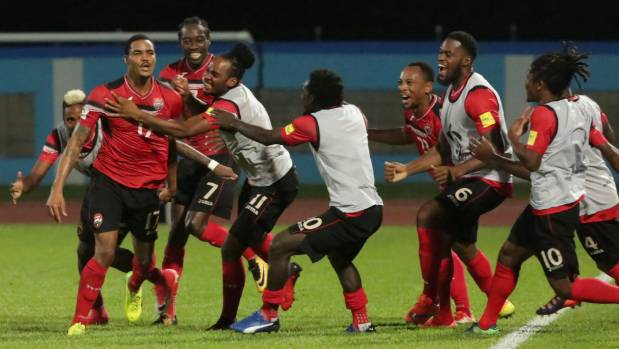 Trinidad's Alvin Jones celebrates his goal with team mates as they build towards a major upset of the United States.