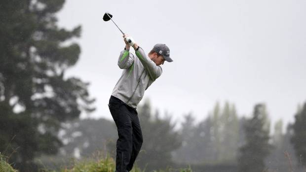 Harry Bateman tees off in the Christchurch rain on his way to the 2017 Charles Tour Harewood Open golf title.