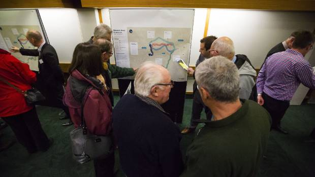 People inspect the final four options at an information session in Palmerston North.