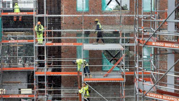 Construction workers on site at Wellington East Girls' College. Meanwhile, its business as usual for the students, even ...
