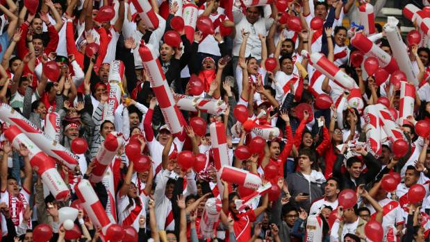 Peruvian fans before the match against Colombia.