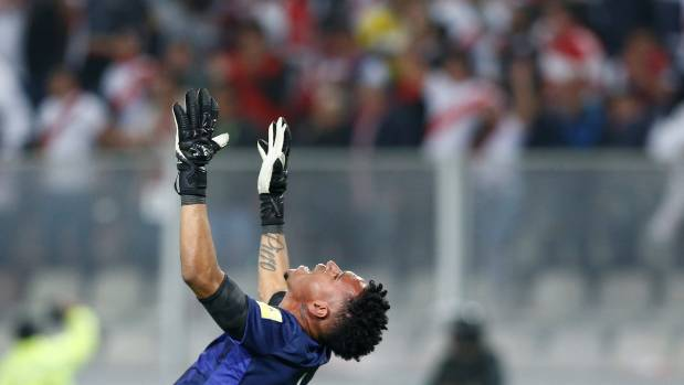 Peru's goalkeeper Pedro Gallese celebrates getting through to the next stage of World Cup qualifying.