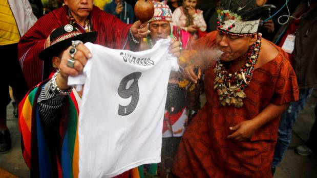 A Peruvian shaman performs a ritual on a Paolo Guerrero shirt prior to the striker scoring a crucial equaliser against ...