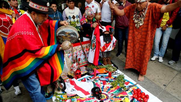 Peruvian shamans perform a ritual prior to the match against Colombia.