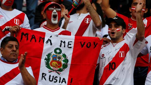 "Peruvian fans before the match against Colombia. The text on the flag reads: ""Mum, I'm going to Russia""."
