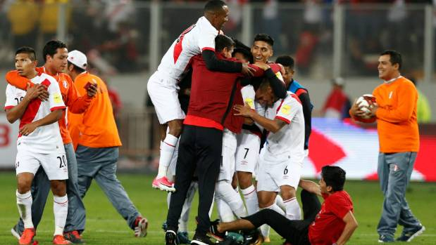 Peru's team players celebrate their draw against Colombia that earned them the playoff against New Zealand.