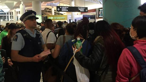 Police and extra airport staff were brought in to help manage the backlog of passengers after a technical error caused a ...