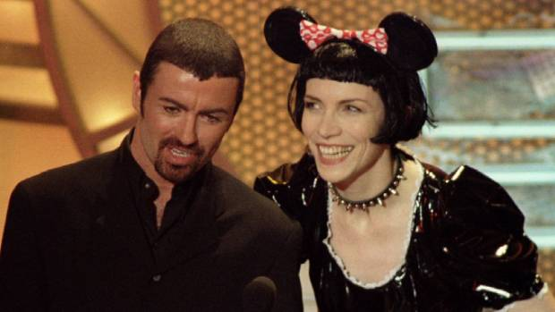 George Michael with fellow British pop star Annie Lennox in 1995.