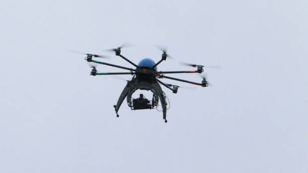 One day drivers may be able to summon a drone to juice up their car battery (file photo).