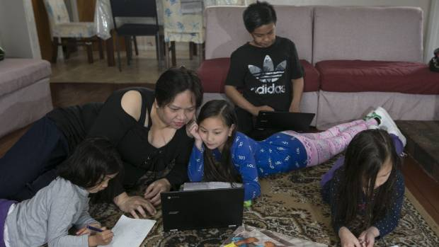 Bernadette Elsera, left, is among an estimated 91 per cent of Asian-New Zealand parents who want their children learning ...