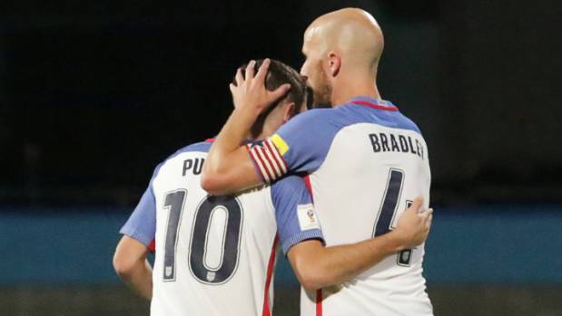 US footballers Christian Pulisic and Michael Bradley hug after losing to Trinidad and Tobago to spell the end of their ...