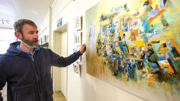 Waimate Art Society president Robert Ireland prepares for the annual exhibition opening which begins on Friday.