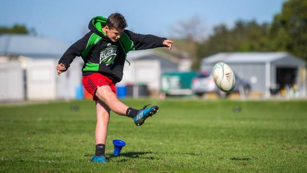 Taine Cordell, 14, takes a shot at goal in the super boot challenge.