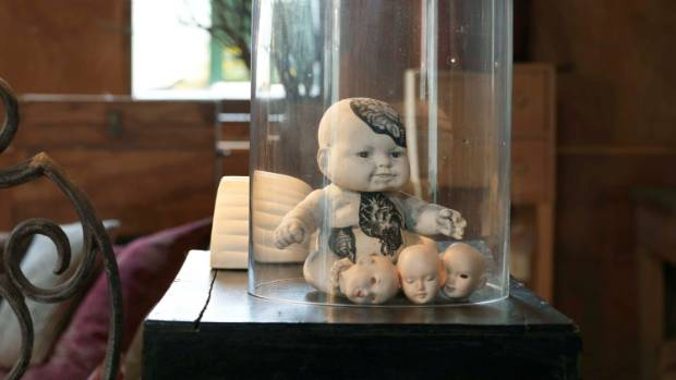 Dolls in a glass dome would be a spooky talking point.