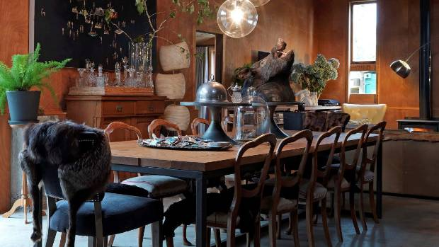 A Halloween table can be decorated elegantly yet spookily with antiques and taxidermy.