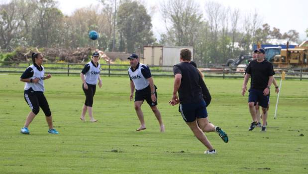Players in action  during a game of touch.