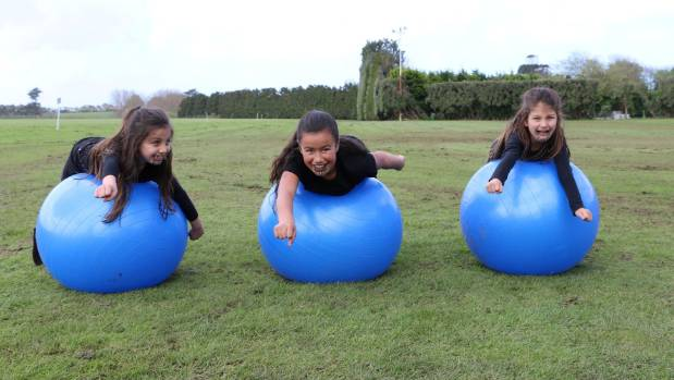 Tianara Domb, Jade Te Wiki and Oriwa Domb had fun balancing on huge exercise balls during a fun day held to celebrate ...