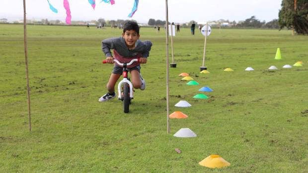 Jaxson Holden, 7, enjoys a spin around a fun bike course.