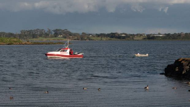 Papakura Rescue One tows the recovered boat to shore in April.