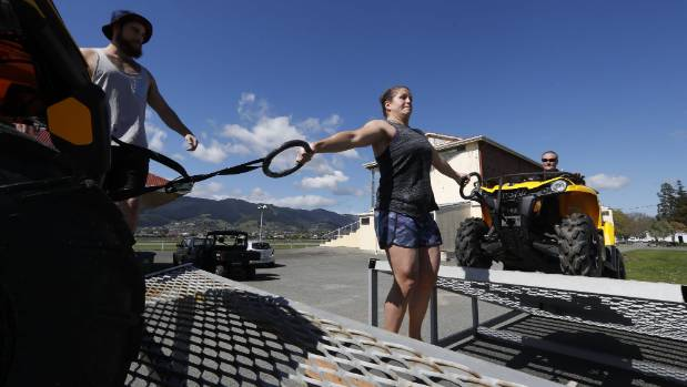 Stephani Mitchell tries to hold two 350 quad bikes during training for the Taylor's Cars Strongman Challenge for the ...