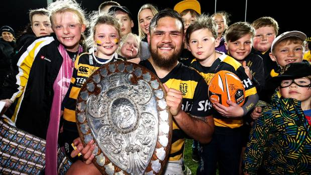 Angus Ta'avao of Taranaki poses with young fans after defending the Ranfurly Shield.
