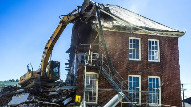 The former Timaru Hospital administration building being demolished on Thursday morning.