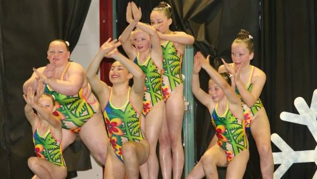 Phoenix Synchronised Swimming Club dolphin black team from left, Ruby Goodall, Aimee Roxburgh, Onevai Pita, Erin ...