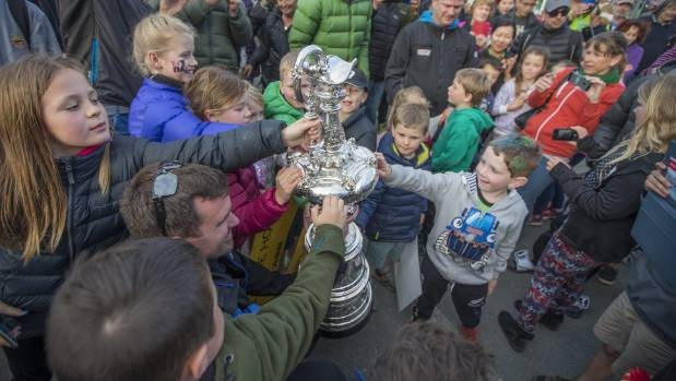 Young fans get a feel of the cup.