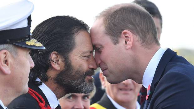New Zealand's only living Victoria Cross recipient, Willie Apiata, greets Prince William with a hongi at the New Zealand ...