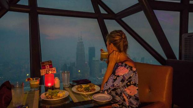 A buffet dinner up the KL Tower costs $75 per person.