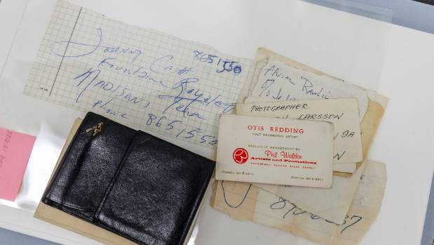 Among the Dylan archive collection are a paper with Johnny Cash's phone number and a business card for Otis Redding.