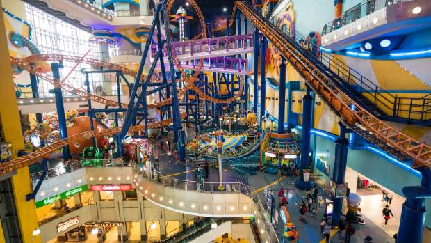 The roller coaster at Berjaya Times Square comes within centimetres of shoppers at the mall.